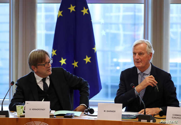 The European Union's Chief Brexit Negotiator Michel Barnier, right, and Guy Verhofstadt, the European Parliament's Brexit steering group coordinator, attend a Brexit meeting at the European Parliament in Brussels, Belgium, Oct. 2, 2019.