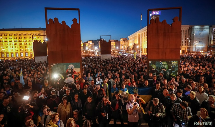 People attend a rally against the approval of the so-called Steinmeier Formula, in Kyiv, Ukraine, Oct. 2, 2019.
