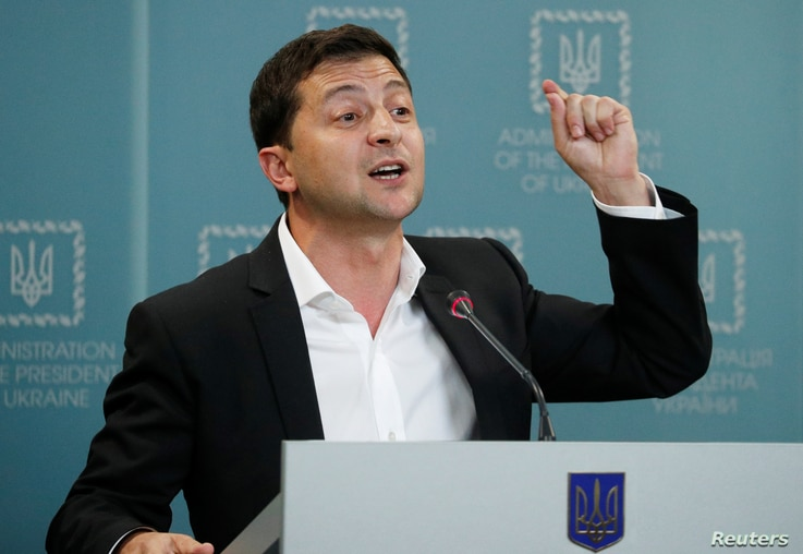 FILE - Ukrainian President Volodymyr Zelenskiy speaks during a news conference in Kyiv, Ukraine, Oct. 1, 2019.
