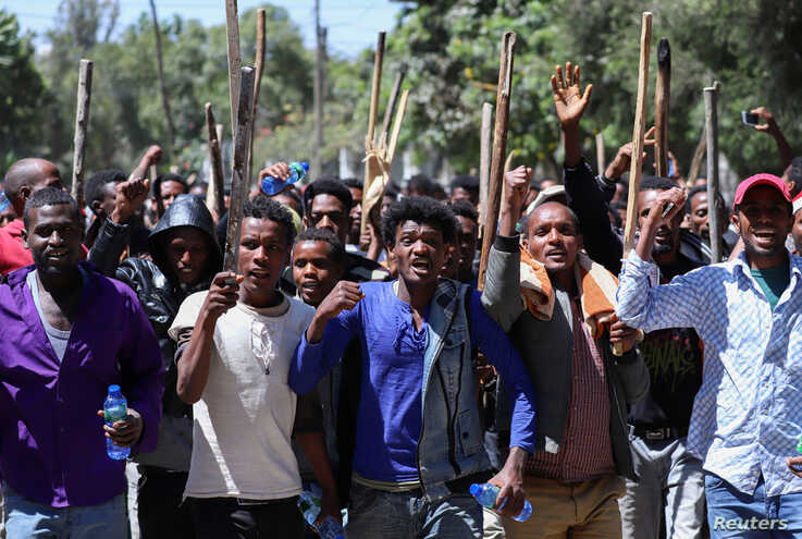 Oromo youth chant slogans during a protest in-front of Jawar Mohammed's house, an Oromo activist and leader of the Oromo protest in Addis Ababa, Ethiopia, Oct. 24, 2019.
