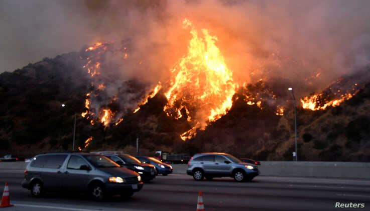The Getty Fire burns near the Getty Center along the 405 freeway north of Los Angeles, California, Oct. 28, 2019.
