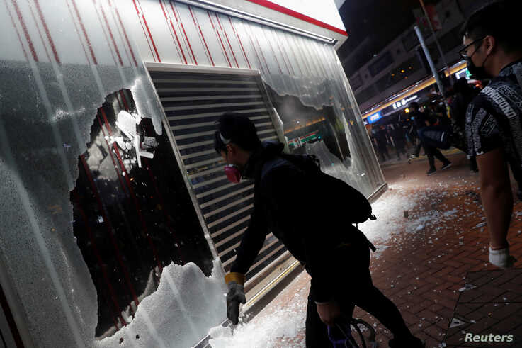 Anti-government protesters vandalize Bank of China branch during a protest in Tsuen Wan in Hong Kong, Oct. 13, 2019.