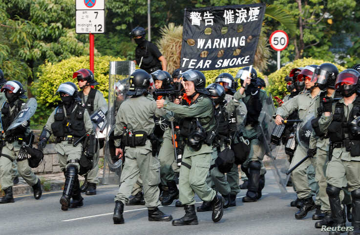 Riot police officers patrol Tai Po district during an anti-government protest in Hong Kong, China, Oct. 13, 2019.