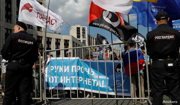 "People hold a banner reaPeople hold a banner reading ""Hands off the Internet"" during a rally in protest against court decision to block the Telegram messenger because it violated Russian regulations, in Moscow, Russia, May 13, 2018. ding ""Hands off the Internet"" during a rally in protest against court decision to block the Telegram…"