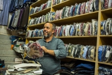 Hussain, a 42-year-old shopkeeper says his city has been ruled by four different groups since 2011, including Islamic State militants, Aug. 30, 2019 in Manbij, Syria. (VOA/Yan Boechat)
