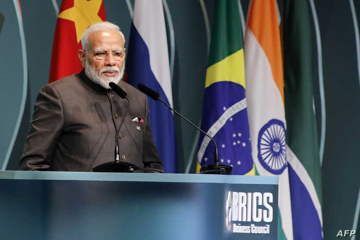 India's Prime Minister Narendra Modi speaks during the BRICS Business Council prior to the 11th edition of the BRICS Summit, in…