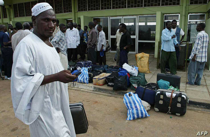 A Khartoum-based trader is pictured at Juba International Airport, 04 August 2005, where Arab traders have sought refugee after…
