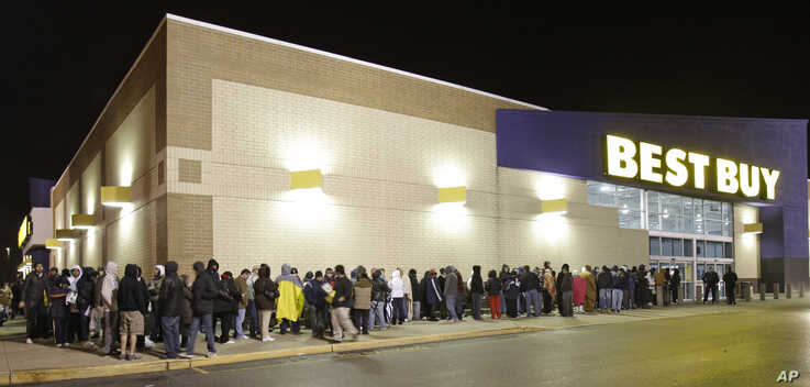 File -- Hundreds of shoppers line up for Black Friday deals at Best Buy in Mayfield Heights, Ohio.