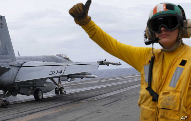 A U.S. fighter jet takes off from the U.S. aircraft carrier USS Ronald Reagan for their patrol at the international waters off…
