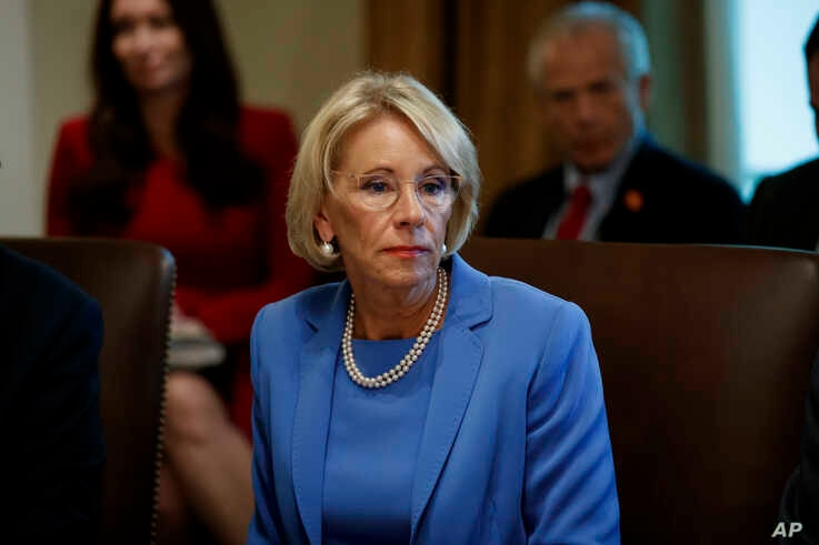 FILE - In this July 16, 2019, file photo, Education Secretary Betsy DeVos listens during a Cabinet meeting in the Cabinet Room…
