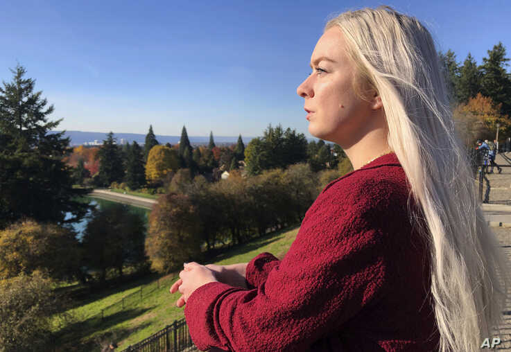 In this Oct. 28, 2019, photo, Ashtyn Aure poses for a photo in Portland, Ore. When Aure visited a clinic at Utah Valley…