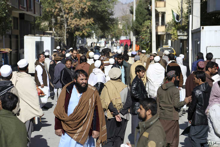 People gather outside of the Pakistan Embassy in Kabul, Afghanistan, Monday, Nov. 4, 2019. The Pakistan Embassy issued a…