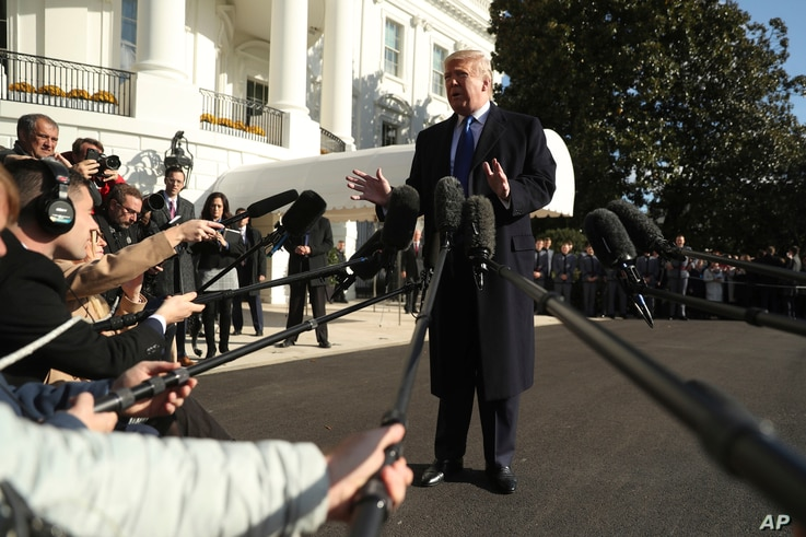 President Donald Trump speaks to reporters on the South Lawn of the White House in Washington, Friday, Nov. 8, 2019, before…