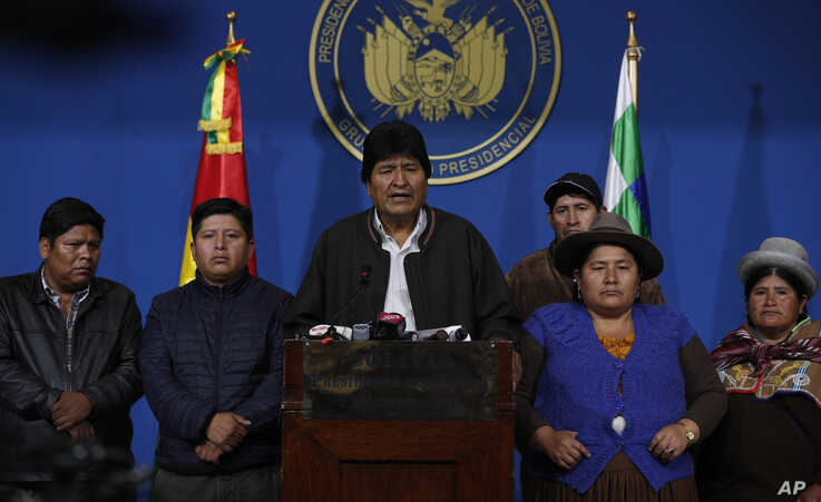 Bolivia's President Evo Morales, center, speaks during a press conference at the military base in El Alto, Bolivia.