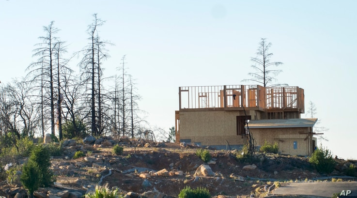 In this Tuesday, Nov. 5, 2019, photo, a new home construction project sits on a hilltop in Santa Rosa, Calif. Many homes in the…