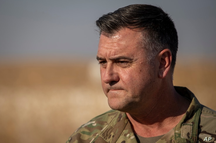 Maj. Gen. Eric Hill addresses the media at a US military base at undisclosed location in Eastern Syria, Monday, Nov. 11, 2019…