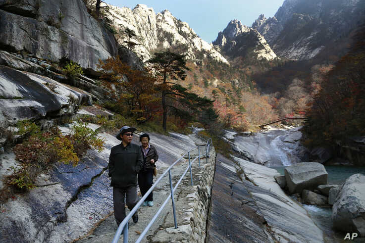 FILE - In this Oct. 23, 2018, file photo, local tourists walk on the trail at Mount Kumgang, known as Diamond Mountain, in…