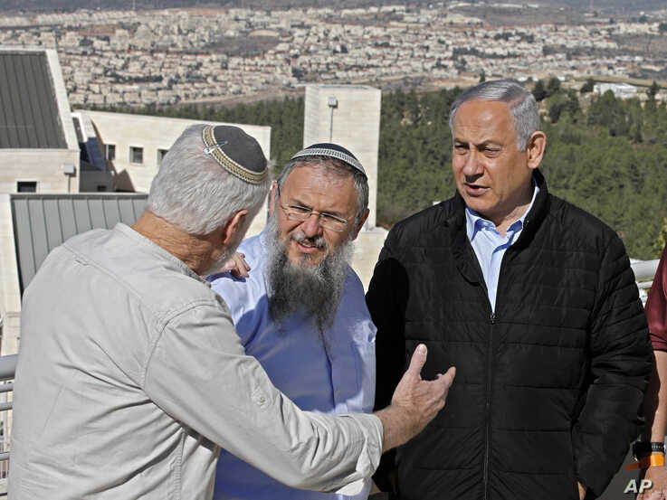 Israeli Prime Minister Benjamin Netanyahu, right, meets with heads of Israeli settlement authorities at the Alon Shvut settlement, in the Gush Etzion block, in the occupied the West Bank, November 19, 2019.
