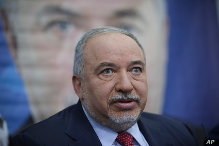 FILE -  Former Israeli Defense Minister and Yisrael Beiteinu party leader Avigdor Lieberman speaks to journalists during a press conference in Tel Aviv, Israel, May 30, 2019.