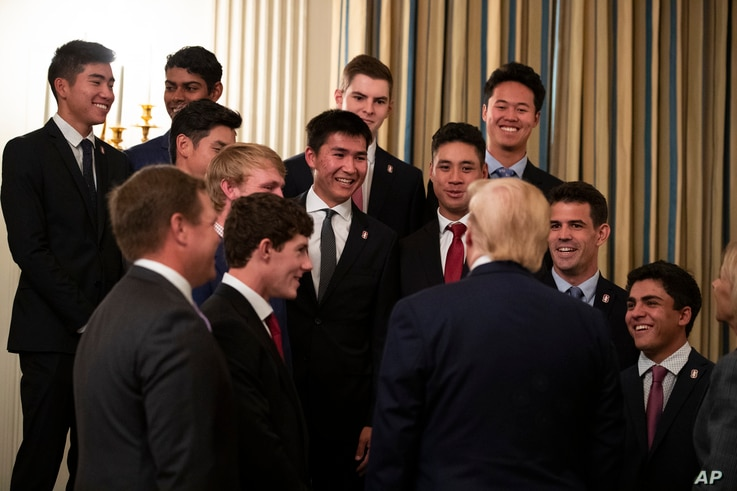 President Donald Trump talks with members of the Stanford University Men's Golf Team during NCAA Collegiate National Champions…