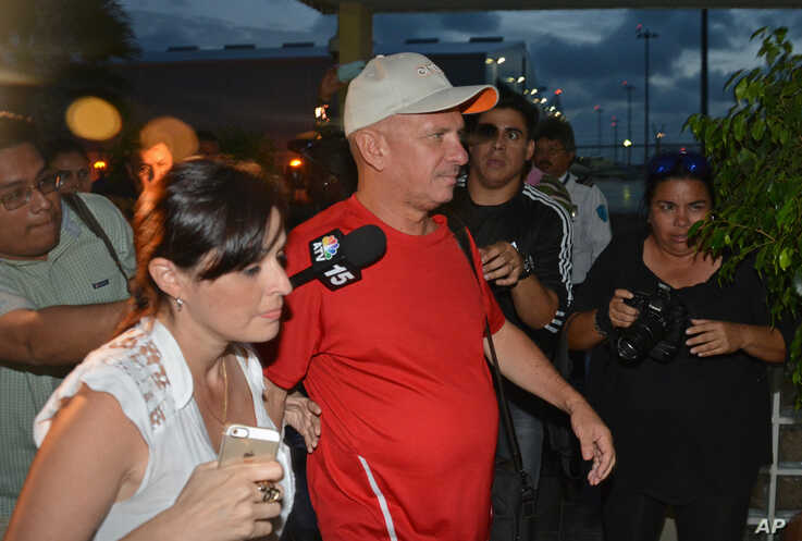 Venezuela's ex-military intelligence chief, Hugo Carvajal, arrives at the Queen Beatrix International Airport after he was…