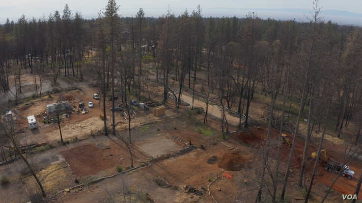 The debris of burned homes and trees has been removed leaving empty lots in a neighborhood in Paradise that was almost completel