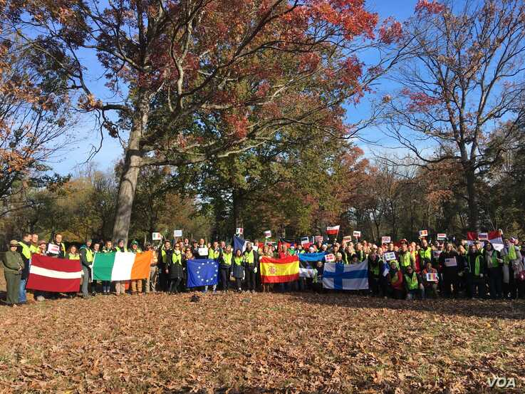 EU countries' representatives joined National Park Service staff and volunteers from Casey Trees to plant oak, holly, tuliptree and American elm trees at Montrose Park in northwest Washington, Nov. 15, 2019. (Natalie Liu/VOA)