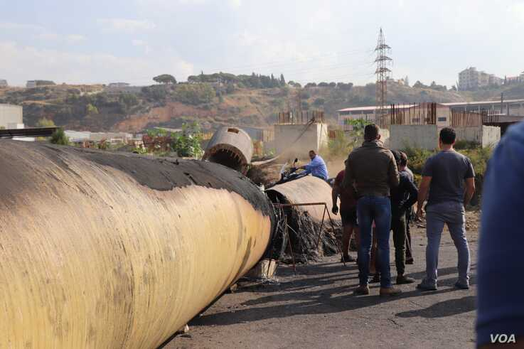 Demonstrators block roads with giant sewage pipes they say come from abandoned factories that have left many locals jobless, outside of Tripoli, Lebanon, Nov. 15, 2019. (Heather Murdock/VOA)