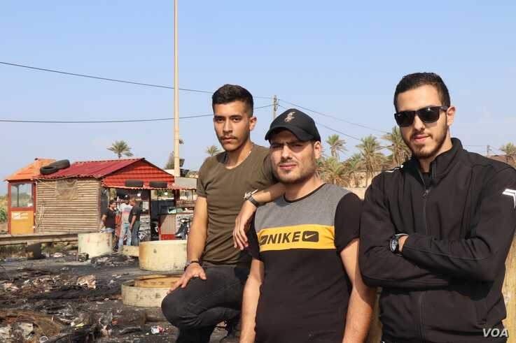 Jalal, 21, left, and his friends Mustafa and Nader say unless you are connected to politicians in Lebanon, it is increasingly difficult to get jobs or basic services, outside of Tripoli, Lebanon, Nov. 15, 2019. (Heather Murdock/VOA)