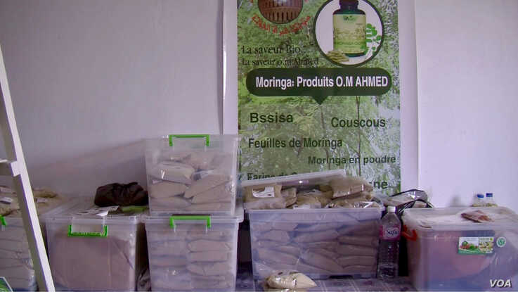 Moringa products made by Samira Sghaier and other local farmers are seen on display. They're having a hard time marketing them. (Lisa Bryant/VOA)
