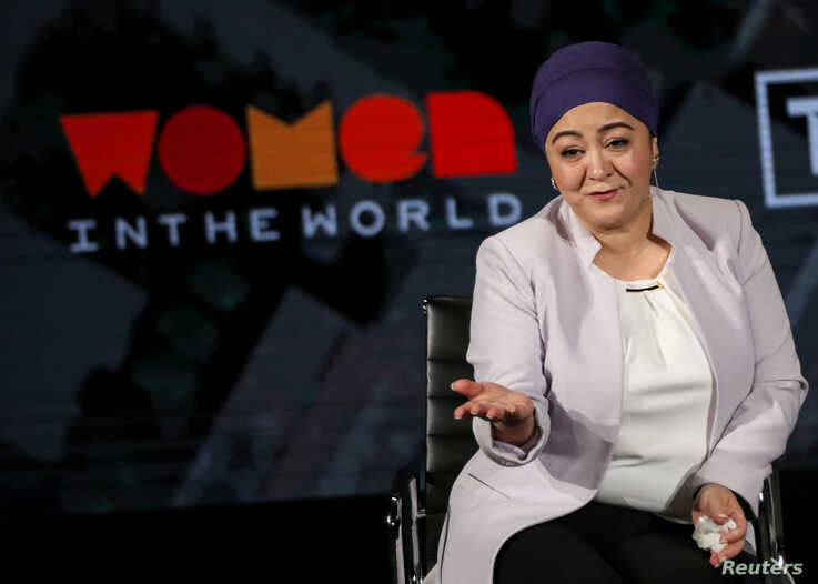 Gulchehra Hoja, Uighur journalist at Radio Free Asia, speaks on stage at the Women In The World Summit in New York, April 11, 2019.