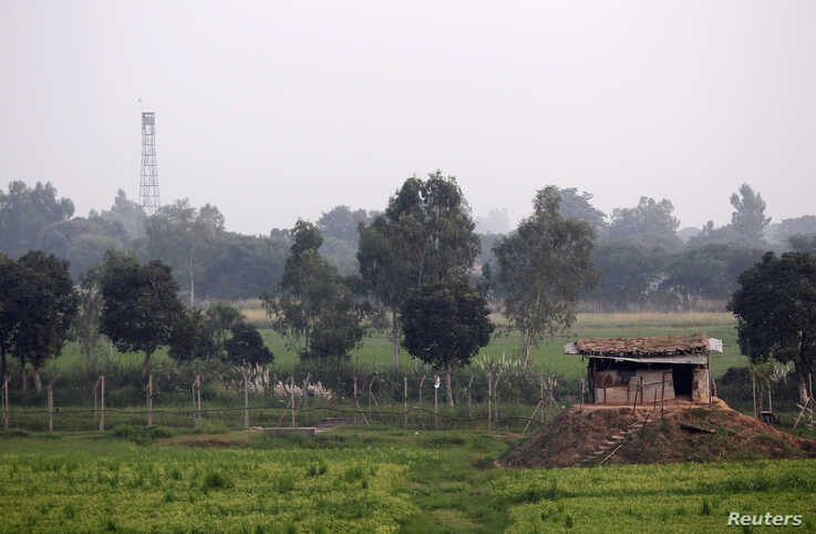 An Indian Border Security Force (BSF) bunker is seen near the fenced border with Pakistan in Suchetgarh, southwest of Jammu,…