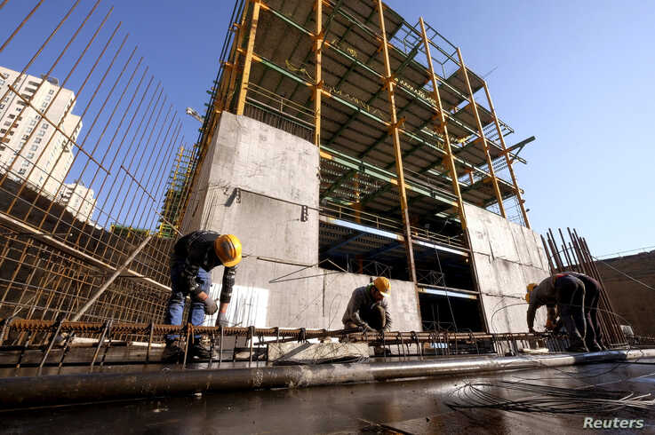 Labourers work at the construction site of a building in Tehran, Iran January 20, 2016.  REUTERS/Raheb Homavandi/TIMA/File…