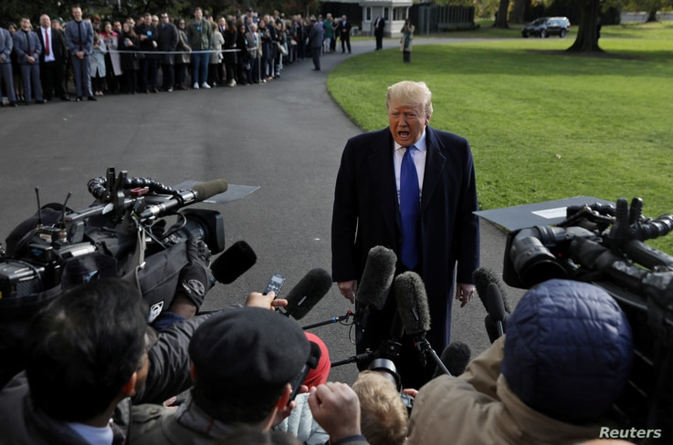 U.S. President Donald Trump speaks to the news media before boarding Marine One to depart for travel to Georgia from the South…