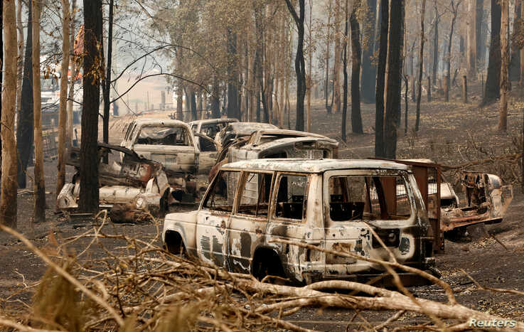 A cluster of burnt out cars sit at a property at Rainbow Flat, Australia, November 11, 2019.  AAP Image/Darren Pateman/via…