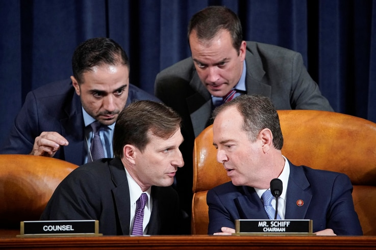 House Intelligence Committee Chairman Adam Schiff (D-CA) speaks with Democratic Counsel Daniel Goldman (L) and other staffers…