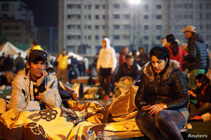 Citizens rest at a makeshift camp in Durres, after an earthquake shook Albania, Nov. 26, 2019.