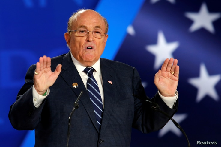 FILE - Rudy Giuliani, former Mayor of New York City, speaks at an event in Ashraf-3 camp, which is a base for the People's Mojahedin Organization of Iran (MEK) in Manza, Albania, July 13, 2019.