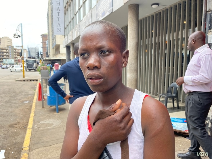 Soft drink vendor Runyararo Mazinyira, 24, says she sustained injures from the police assaults in Harare, Nov. 20, 2019. (Columbus Mavhunga/VOA)