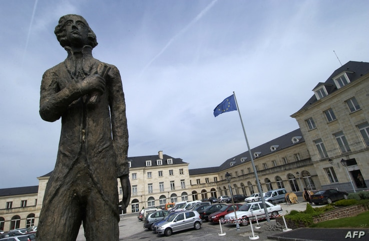 FILE - A statue of French historian and diplomat Alexis de Tocqueville is seen in the town of Saint-Lo, Normandy region, France, May 12, 2005.