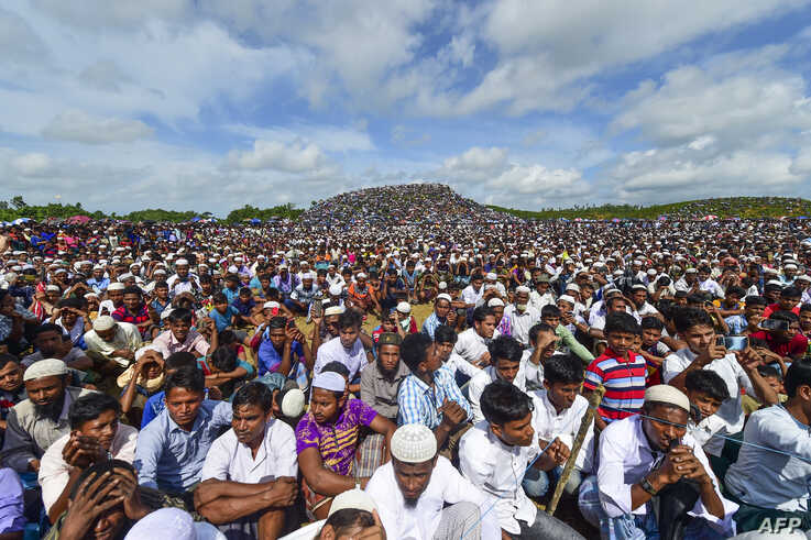 FILE - Rohingya refugees attend a ceremony to mark the second anniversary of the exodus at the Kutupalong refugee camp in Ukhia, August 25, 2019.