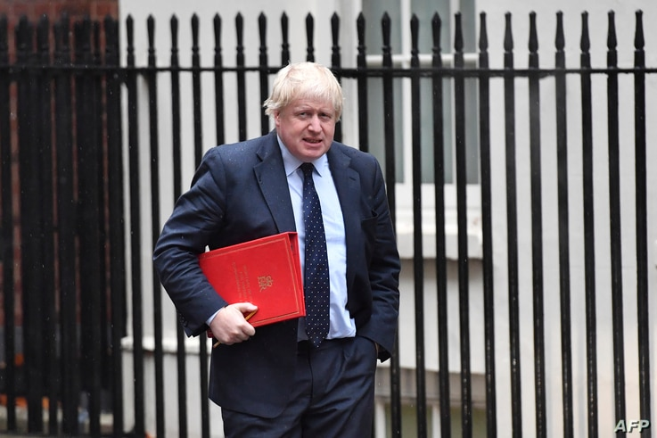 FILE - Boris Johnson, then Britain's foreign secretary, arrives at 10 Downing Street for a weekly meeting of the cabinet, in central London, Britain, Dec 11, 2017.