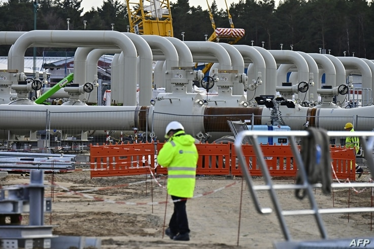 FILE - Men work at the construction site of the so-called Nord Stream 2 gas pipeline in Lubmin, northeastern Germany, March 26, 2019.