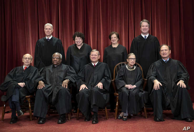 The justices of the U.S. Supreme Court gather for a formal group portrait at the Supreme Court Building in Washington, Nov. 30, 2018.