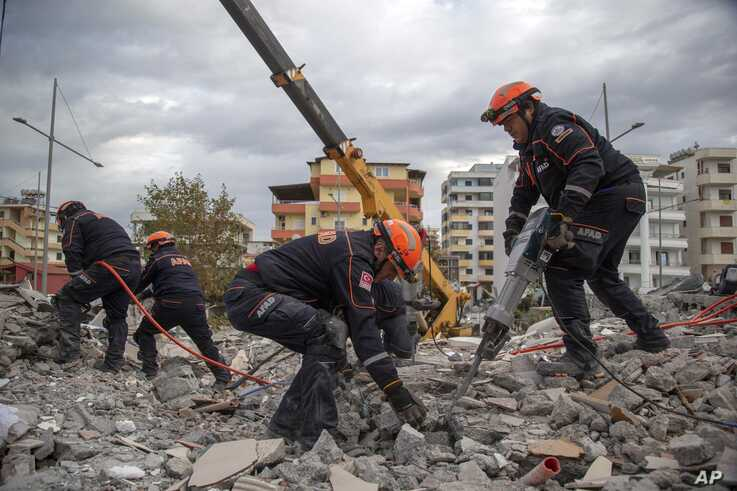 Turkish rescuers search at a collapsed building in Durres, western Albania, Nov. 28, 2019.