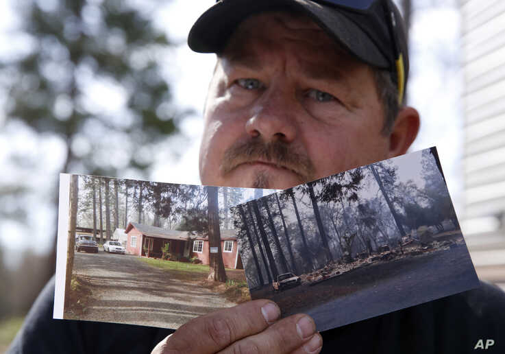 Bill Husa displays before-and-after photos of his home, Oct. 24, 2019, lost in last year's Camp Fire in Paradise, Calif. Husa's
