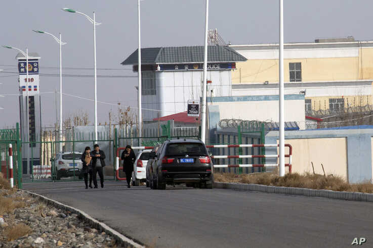 FILE.- A police station is seen by the front gate of the Artux City Vocational Skills Education Training Service Center in Artux in western China's Xinjiang region, Dec. 3, 2018.
