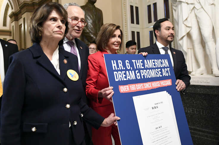 House Speaker Nancy Pelosi. second from right, joined by, from left, Rep. Lucille Roybal-Allard, Senate Minority Leader Sen. Chuck Schumer, and Rep. Joaquin Castro, carry a sign as they walk on Capitol Hill, Nov. 12, 2019.
