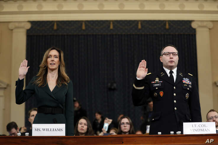 Jennifer Williams, an aide to Vice President Mike Pence, left, and National Security Council aide Lt. Col. Alexander Vindman, are sworn in to testify before the House Intelligence Committee on Capitol Hill in Washington, Nov. 19, 2019.