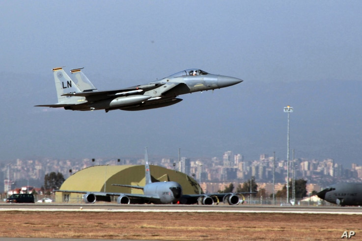 FILE - A U. S. Air Force F-15 fighter jet takes off from Incirlik Air Base, near Adana, Turkey, Dec. 15, 2015.